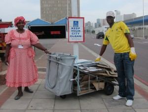 Cardboard recycler Victoria Bubu on the left, being assisted by Sibusiso Zulu