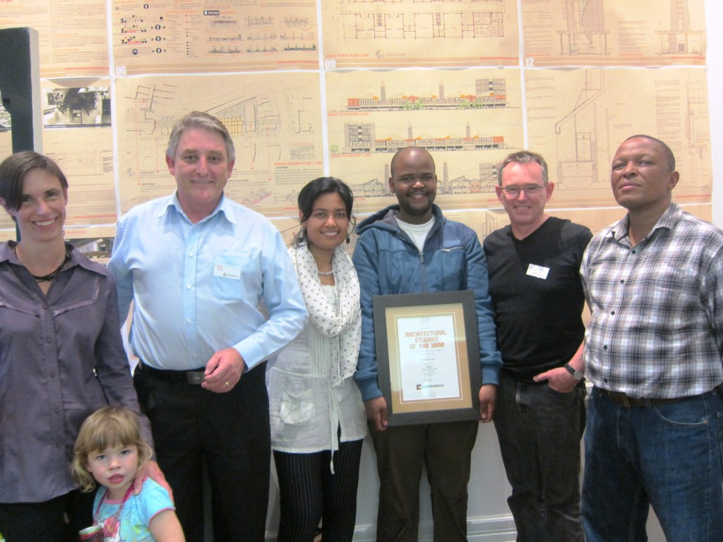 Mongezi in the centre with the award flanked by AeT staff, Corobrick and University of KwaZulu-Natal representatives. Photo: Zoe Horn.