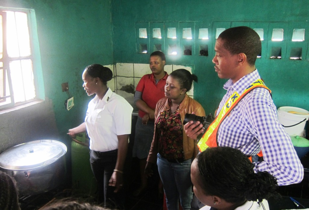 The workplace-safety audit delegation inspecting a food cook's stall. Image: Tasmi Quazi.