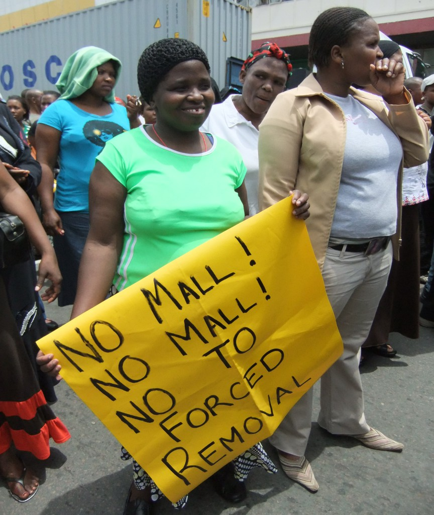 A worker from Warwick Junction's Early Morning Market protests the municipality's failure to consider her livelihood when they approved a mall development plan on the market's site. Photo: R. Douglas Source: