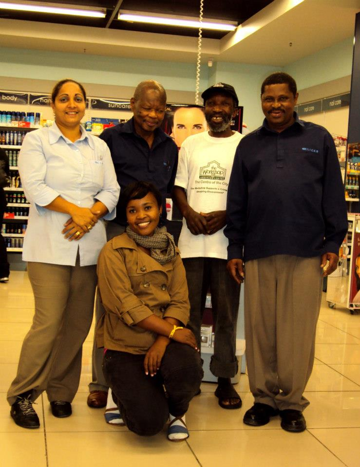 Clicks management at the Workshop Shopping Centre with informal recycler, Afrika Ntuli, who sorts and removes their cardboard and plastic waste recyclables. Picture: Tasmi Quazi